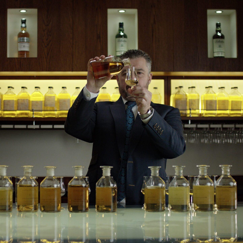Sandy Hyslop pouring blending bottle