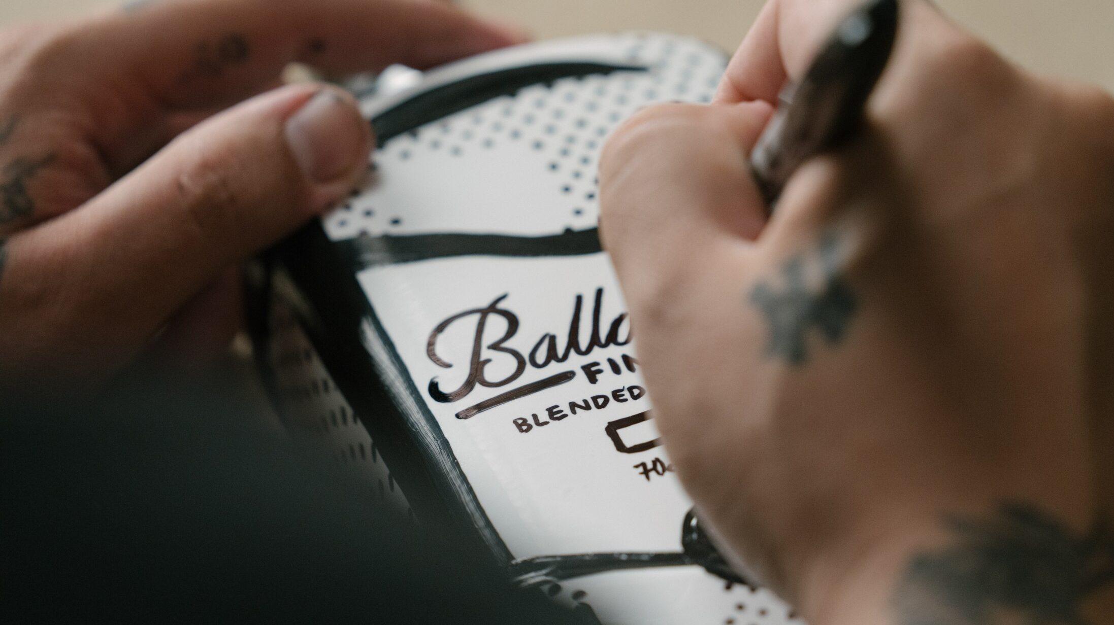 Joshua Vides Signature on Ballantines bottle