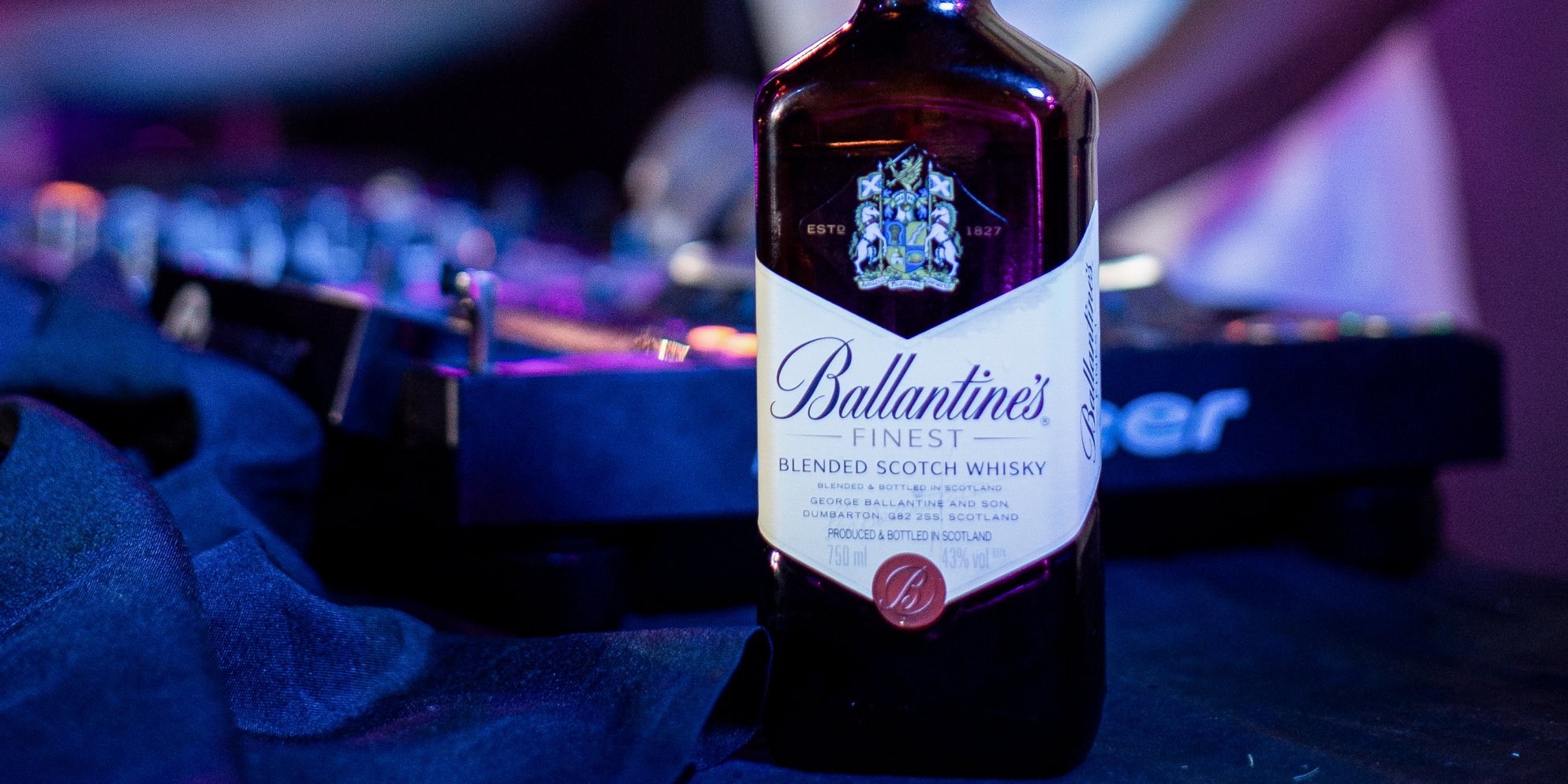 bottle of ballantines and mixing desk